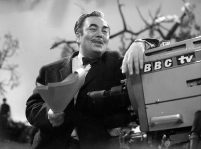 Sydney Newman leaning on BBC TV camera