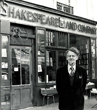 George Whitman in front of bookstore