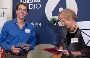 Sue giving Wilson the short story prize